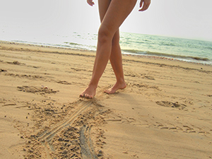 WomanWalkingOnBeach