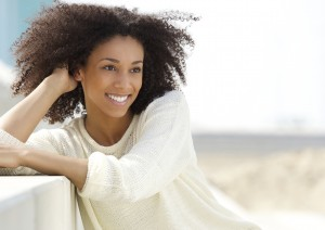 Close up portrait of a beautiful young african american woman relaxing outdoors